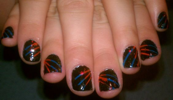 My nails. :) I messed up one finger but the rest came out great. I painted them orange and blue, put striping tape on them, painted them black, removed the tape while it was still wet, and topped it off with holographic glitter.