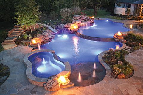Lagoon-style pool with fountain bubblers│Distinctive Pools, Inc., Lewisville, Texas http://www.luxurypools.com/blog/entryid/178/water-in-motion-top-water-features-for-pools.aspx