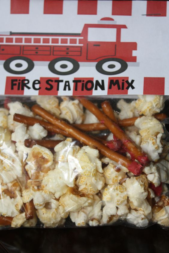 fire truck party snack mix-pretzels sticks dipped in red chocolate (matches) and popcorn (smoke)