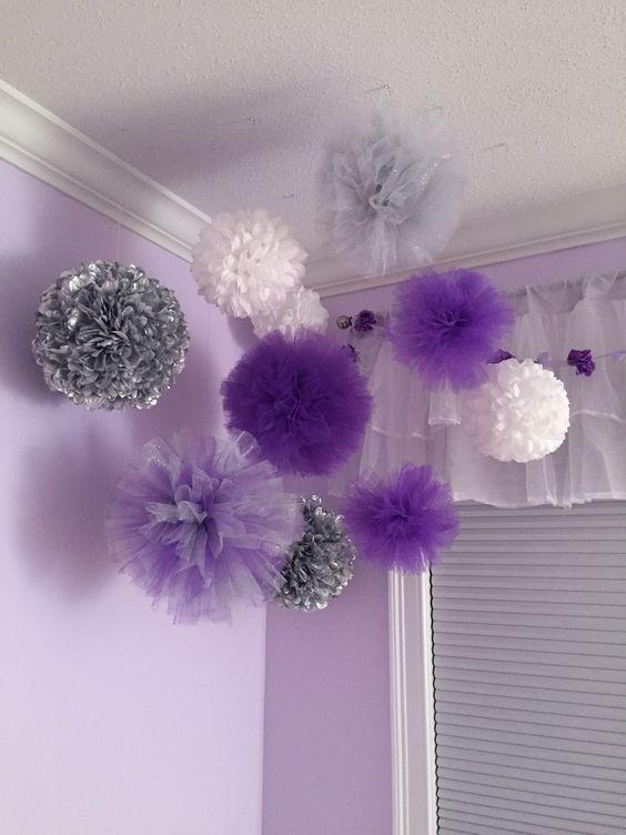Baby nursery purple, lavender, gray pompom decor.