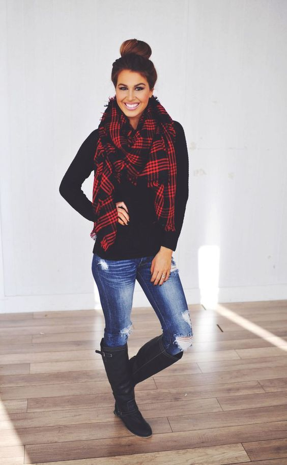 Black shirt, black boots, ripped jeans, and red and black blanket scarf with hair in a bun. (My every day winter look)