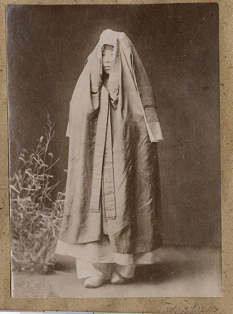 [Korean woman wrapped in cloak] by Cornell University Library, via Flickr: