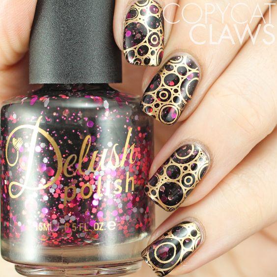 Stamping over Delush Polish's Bitchcraft nail polish. Gold nail stamping.