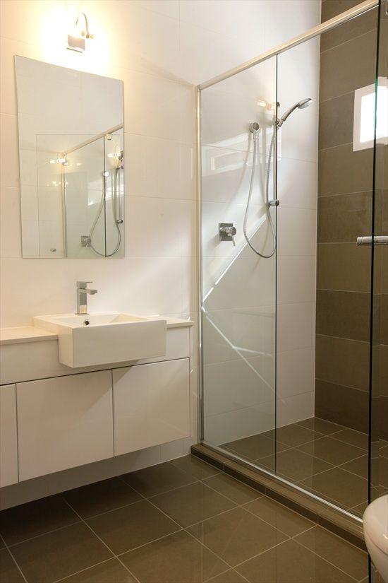 Floor tile in shower like the dark floor against white for 4x4 bathroom ideas