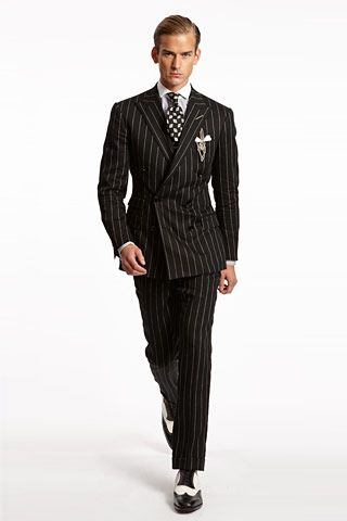 A pinstripe black double breasted suit with fitted waist, dotted
