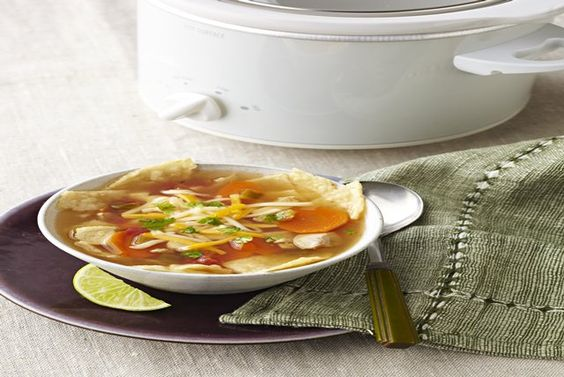 Cheese tops bowls of chicken tortilla soup that literally cooks itself in a slow cooker. Enjoy your time away from the stove!