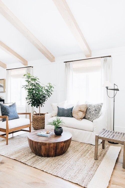 Light Airy Neutral Living Room With Navy Accents Sea Grass Rug Natural Colored Beams Round Wooden Cof Farm House Living Room Home Decor Natural Home Decor