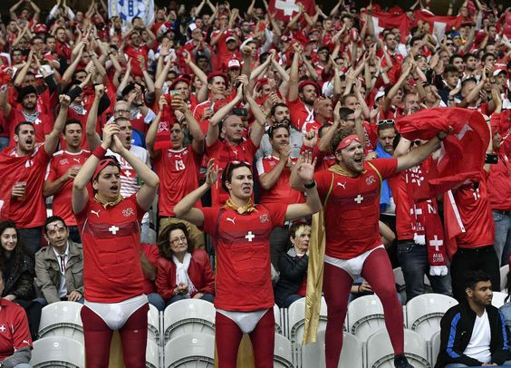Switzerland supporters cheer on the stands before the Euro 2016 Group A soccer match between Switzerland and France at the Pierre Mauroy stadium in Villeneuve d'Ascq, near Lille, France, Sunday, June 19, 2016. (AP Photo/Martin Meissner)/HAS115/343810257596/1606192119