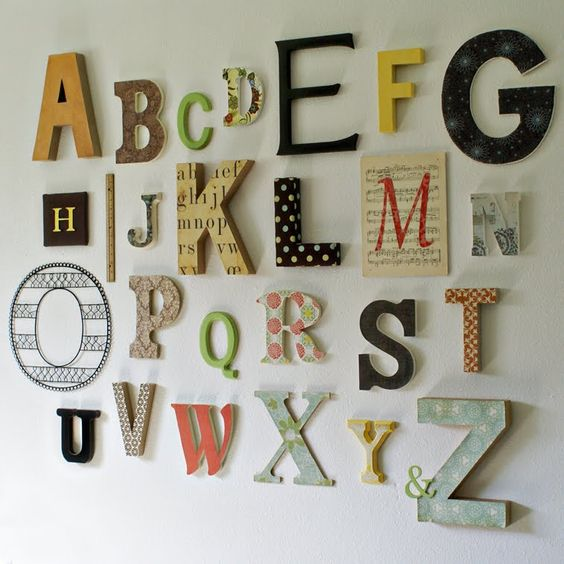 Alphabet wall for a nursery! will have one some day! @Shaina Pearce this can be something fun for the guests at the baby shower that you will be throwing for me (sometime in the NOT near future). each guest is assigned a letter and they bring it decorated to the shower! love love love. =):