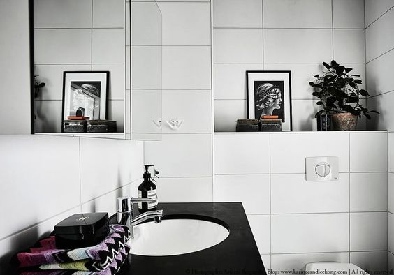 white bathroom in a beautiful apartment with natural accents | large tiles