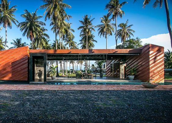 Coconut groves surround NPDA's brick home on a Thai beach