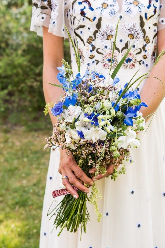 A Swedish Wildflower Wedding With A Colorful Floral Wedding Dress
