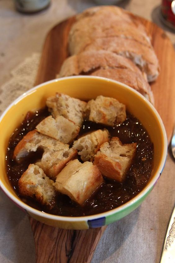 Vegan french onion soup with croutons and sliced ciabatta.