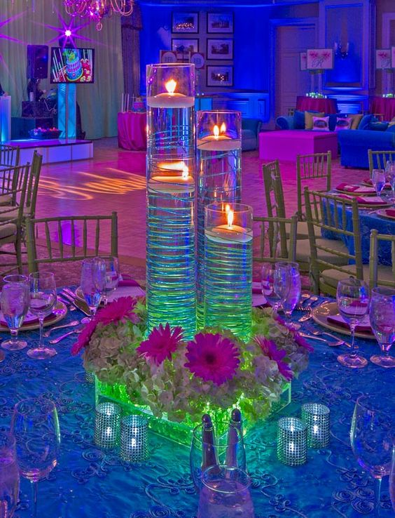 Funky neon lighting with floating candle centerpieces at a Bat Mitzvah.