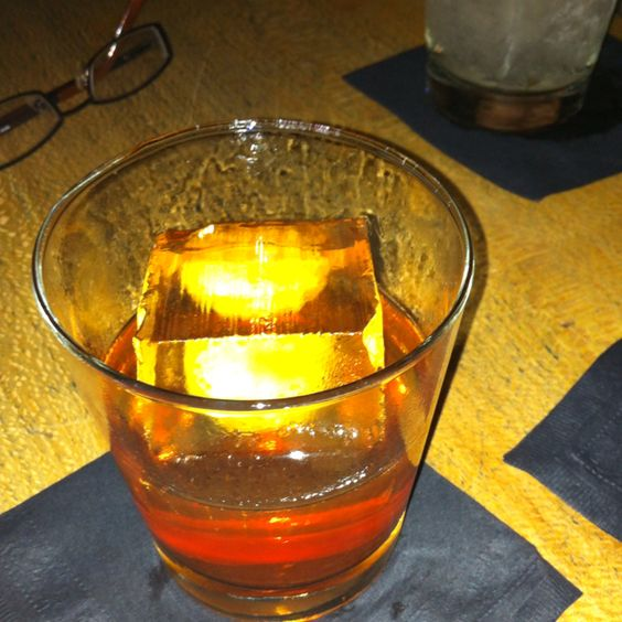 Benton's old fashioned at Please Don't Tell in NYC. Includes bacon-infused bourbon, maple syrup, and bitters.