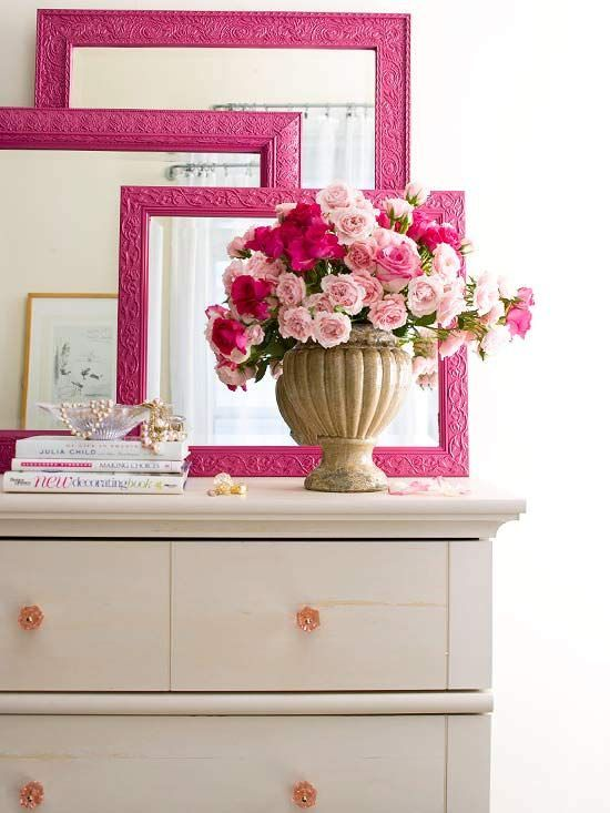 Cute vignette on a dresser. Three mirrors or frames painted the same color and layered.: