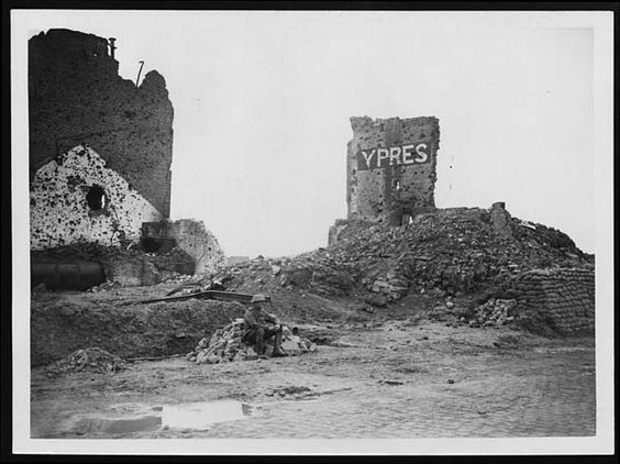 Continuous shell-fire has made this sign necessary    Ypres, Belgium, during World War I. A single soldier is sitting on a pile of rubble in front of ruins painted with the name ' Ypres.'    Ypres became a symbol of the devastation of the war. For most of the war it was in Allied hands, but it was overlooked by the Germans on the higher ground to the east and they shelled it mercilessly.