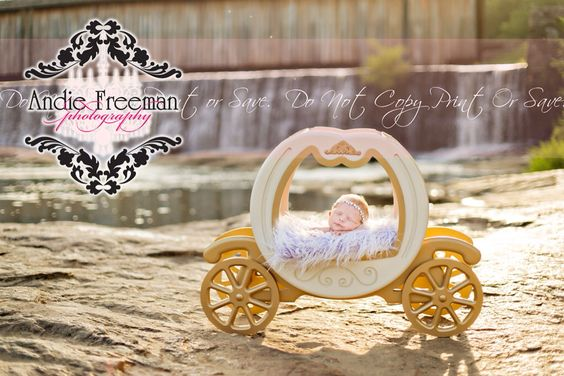 Newborn baby girl in Cinderella carriage in front of waterfall.  Outdoor newborn session. Andie Freeman Photography.  www.TheAthensNewbornPhotographer.com