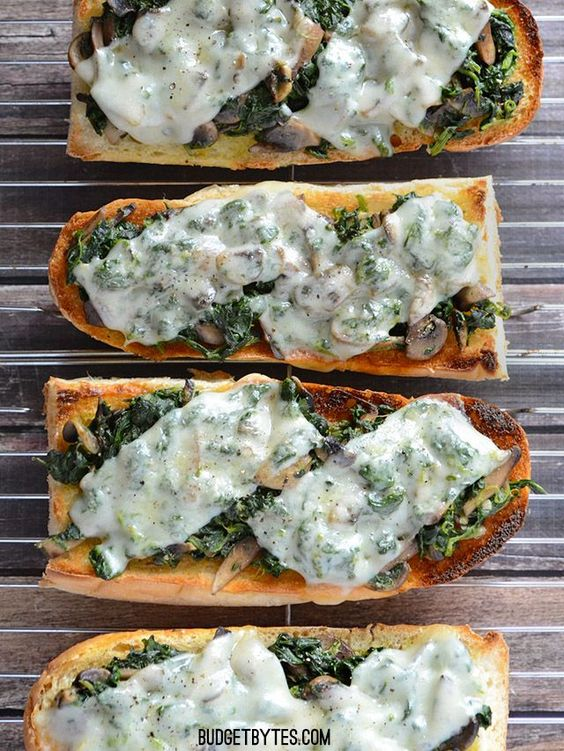The super fast Mushroom Spinach and Swiss French Bread Pizzas cook in just a few minutes under the broiler so you can get your pizza fix fast (and healthy). Mushroom Spinach and Swiss French Bread Pizzas by @budgetbytes