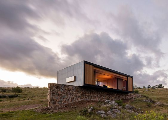 This compact house was prefabricated in a factory near Montevideo, before being transported to an olive grove surrounded by rolling hills