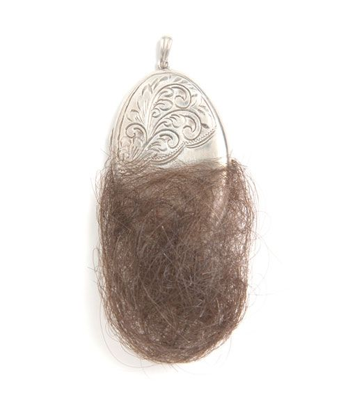 Dionea Rocha Watt Pendant: Protection Locket, 2006 Silver, human hair 3.1 x 5.5 cm Piece for section History, Memory, Tradition:
