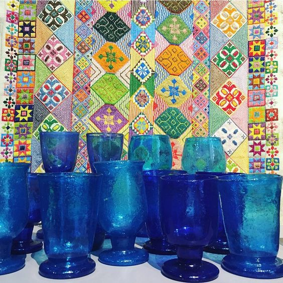 Turquoise Mountain sources traditional glass from the city of Herat. Herati glassware has a rich history, dating back to the Timurid dynasty of the 14th century.  A selection of mixed blue and green glassware is now available in our Upstairs Shop #pippasmall #TheUpstairsShop #heratiglass #turquoisemountain #glassware #handcrafted #Afghanistan