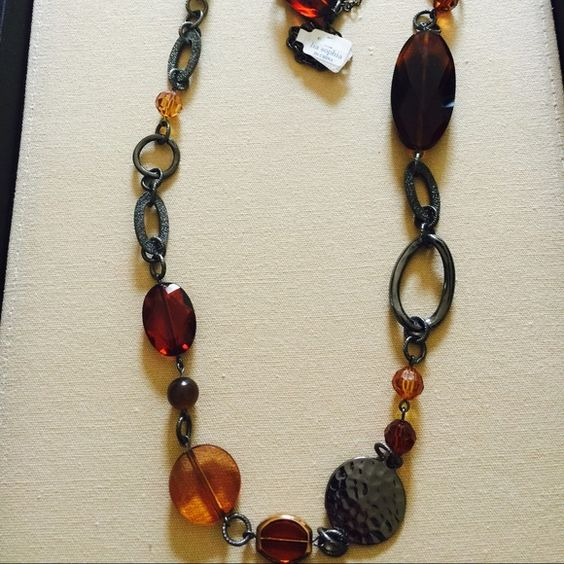 Pretty long brown stones necklace Brand new! Measures 42 inches long can be shorten to 32 inches. Lots of versatility to be double up as two necklaces. Pretty brown color stones with rhodium plated gun metal grey color metal. Great quality! Lia Sophia Jewelry Necklaces