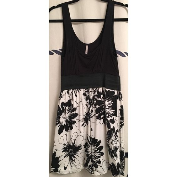 ↠Black & White Floral Tank Dress↞ ↠Black & White Floral Tank Dress↞  Elastic band in the middle. Scoop neck tank up top. Soft. Fitted top, loose bottom   No Trades, PayPal, lowballing Dresses Mini