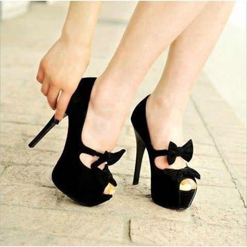 Black heels with a bow, I love these heels.