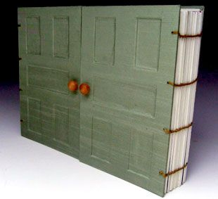 French doors bookbinding. Wouldn't this be interesting and fun to see on a coffee table with family photos!! It looks endearing to me:)