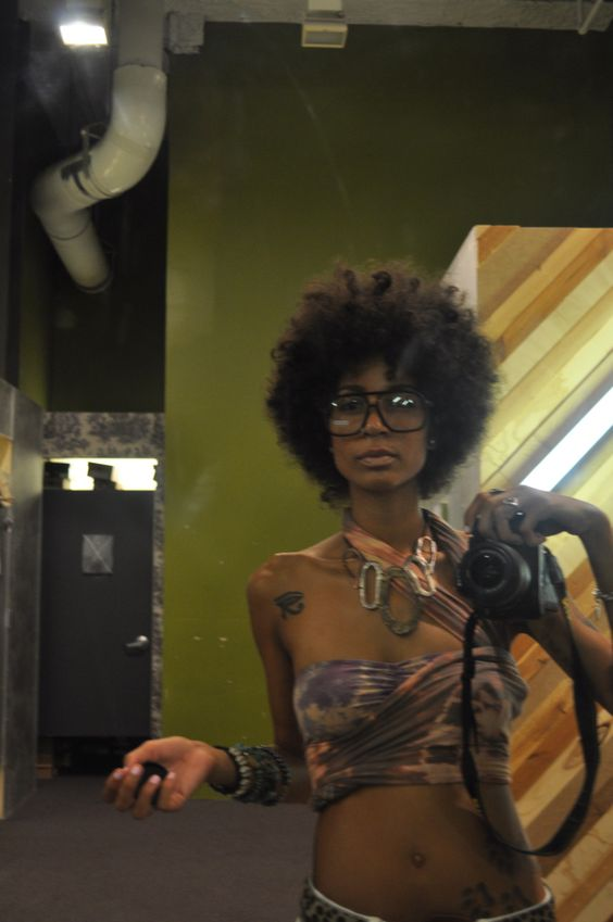 ...big afro - glasses and african tatts
