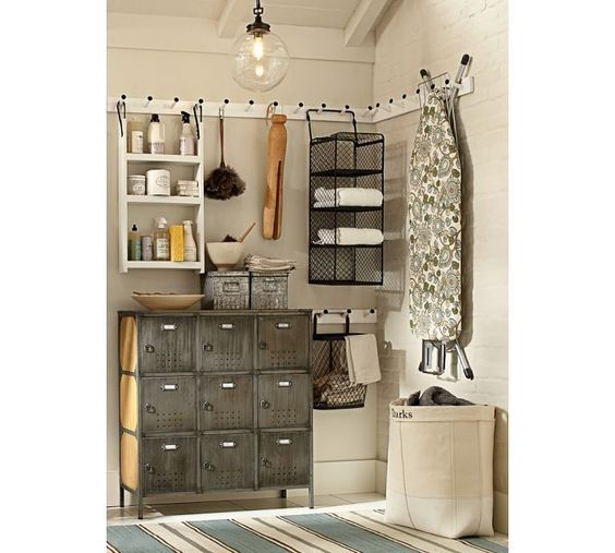 laundry room storage using a wrap around board with pegs
