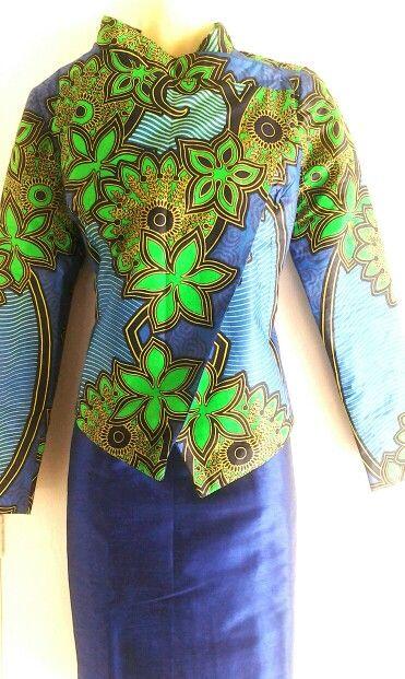 Assymetric African print jacket worn with silk shift dress