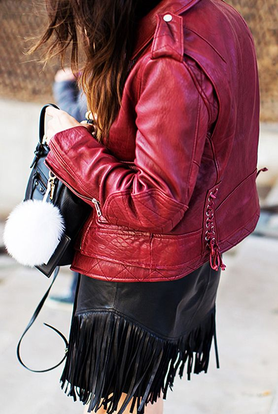 Red leather moto jacket paired with a black fringe skirt: