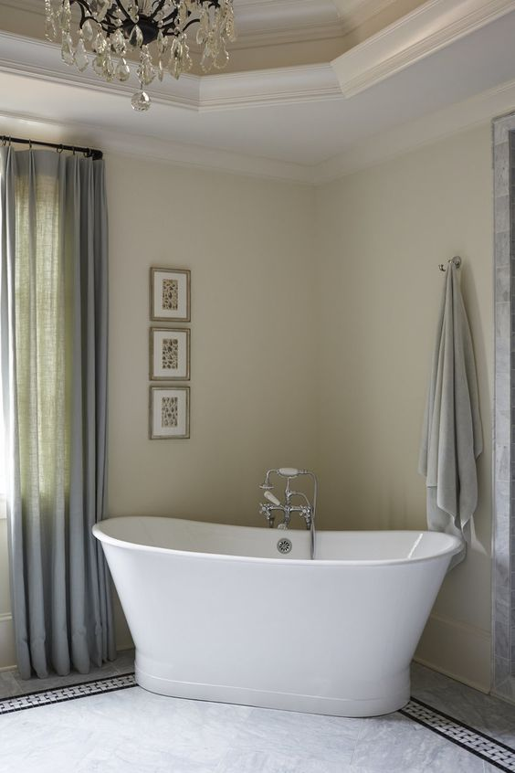 Freestanding tub in an elegant traditional style bathroom by Amy Meier. Jo Malone London Body & Hand Wash (In case you need it!)
