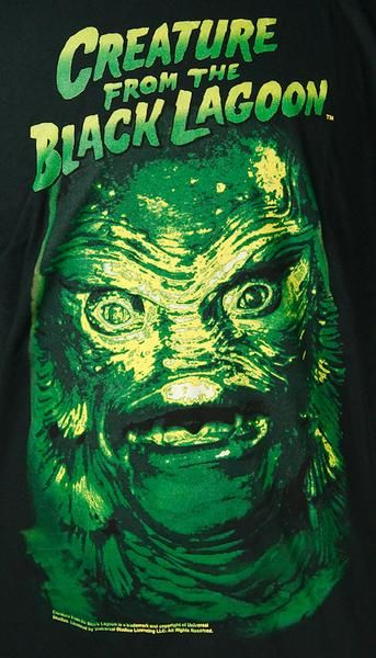 This is a mens black t-shirt with the Universal Monster Creature from the Black Lagoon on the front. The image is a large up close picture of the Creature's face.