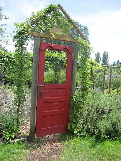 Red Garden door with trellised doorway and wire fence. It is the doorway to the herb gardens at  at Edgefield McMenamins'