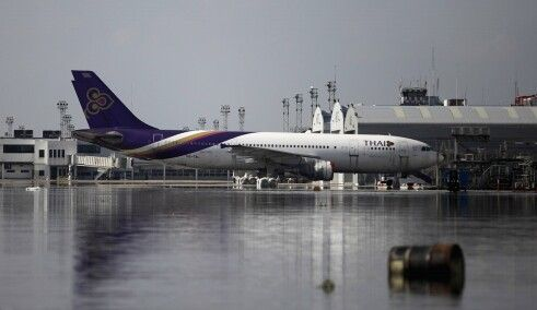 Thai Airways' aircraft is parked at the flooded maintenance center in Don Mueang airport in Bangkok, Thailand, Wednesday, Oct. 26, 2011. Altaf Qadri / AP