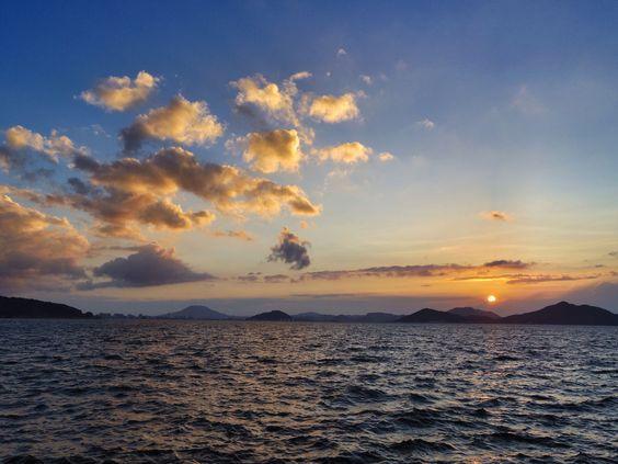26 July 19:08 博多湾対岸の稜線上の雲に、早めの日の入りです。 #sunset #fukuoka ( Evening Now at Hakata bay in Japan)
