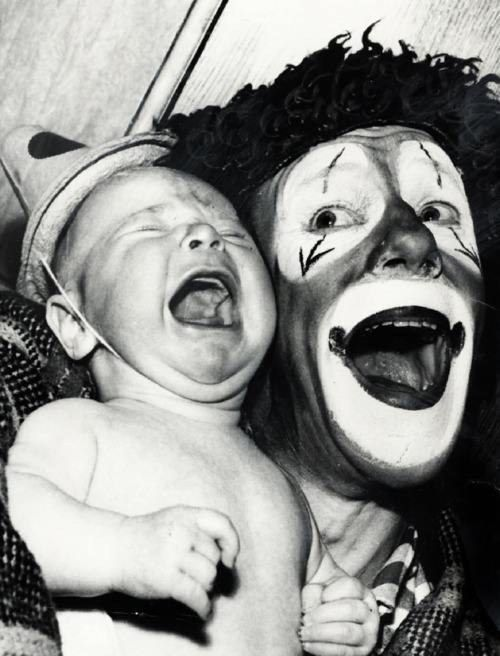 This baby's face says it all. | 21 Vintage Clown Photos That Will Make Your Skin Crawl