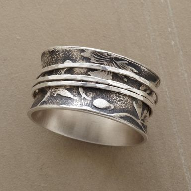 Three sinewy silver bands circle a botanical relief on this hand-wrought sterling silver ring. Handmade for Sundance. Whole sizes 5 to 9.