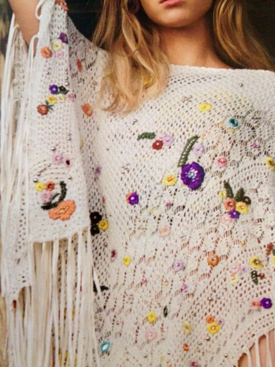 Emilio Pucci Embroidered cotton-blend crochet poncho.  From InStyle.  LOVE the drape, fringe & blend with embroidery!