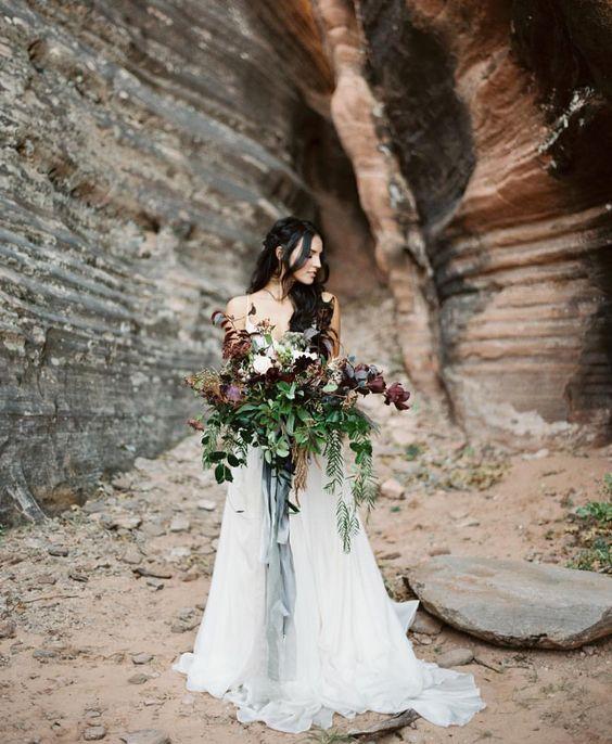 photo tyler rye  bouquet by bloomers  dress by alta moda bridal