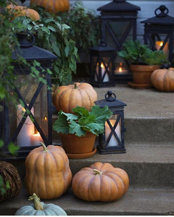 Simple autumn style on the porch... Loads of pumpkins, potted cabbage & candles flickering in cast iron lanterns just speak my language-…