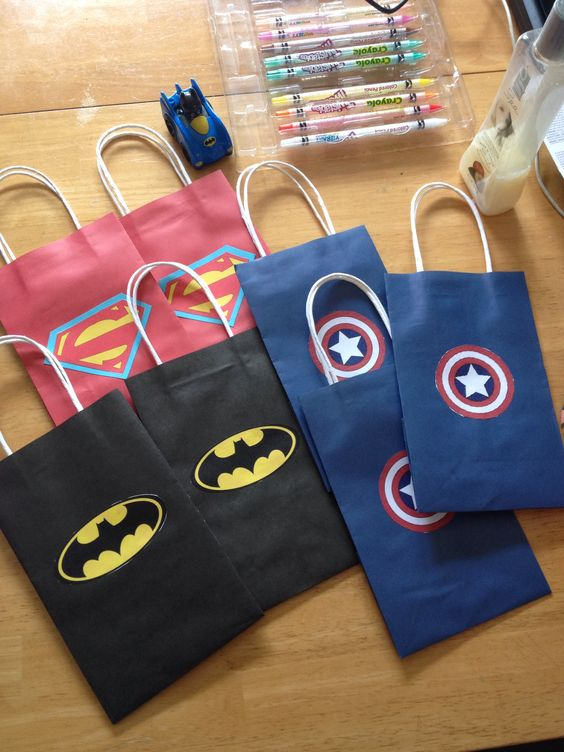 Loot bags for superhero party.  Just printed logos, cut them out, then glued them on.  Fifteen minutes!: