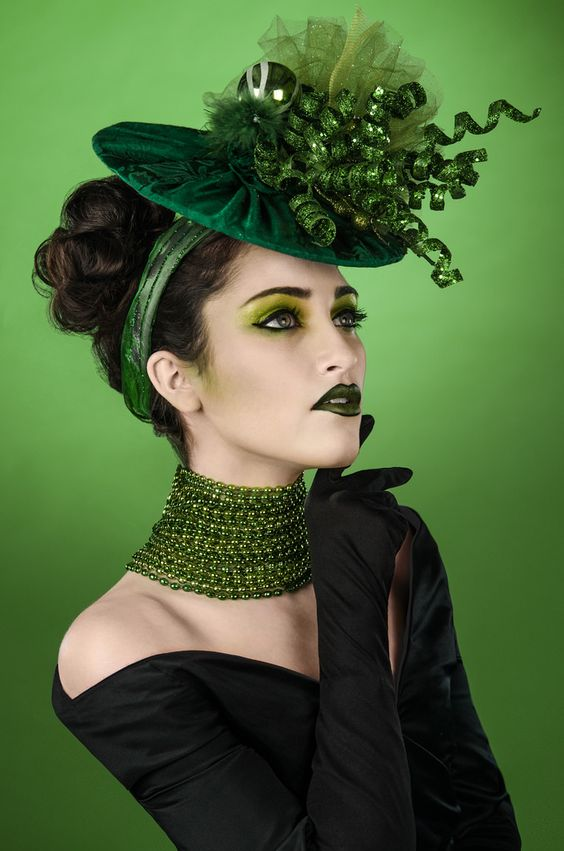 """A series of fashion portraits inspired by the costume design of the Emerald City Oz characters from the Broadway play Wicked, during the song """"One Short Day""""  Model: Jamie Auld Make Up: Bri Trischitta Hair: Bri Trischitta Styling: Bri Trischitta and Danni Siminerio Photo: Danni Siminerio"""