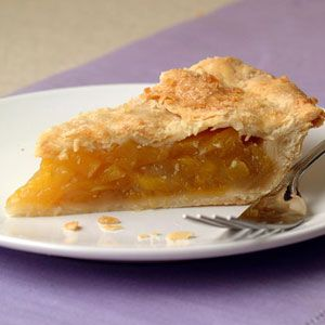 Mango Pie | MyRecipes.com - A fresh alternative to the classic peach pie, mango offers a sweet and juicy flavor that compliments the crystallized ginger and tender, flaky crust.