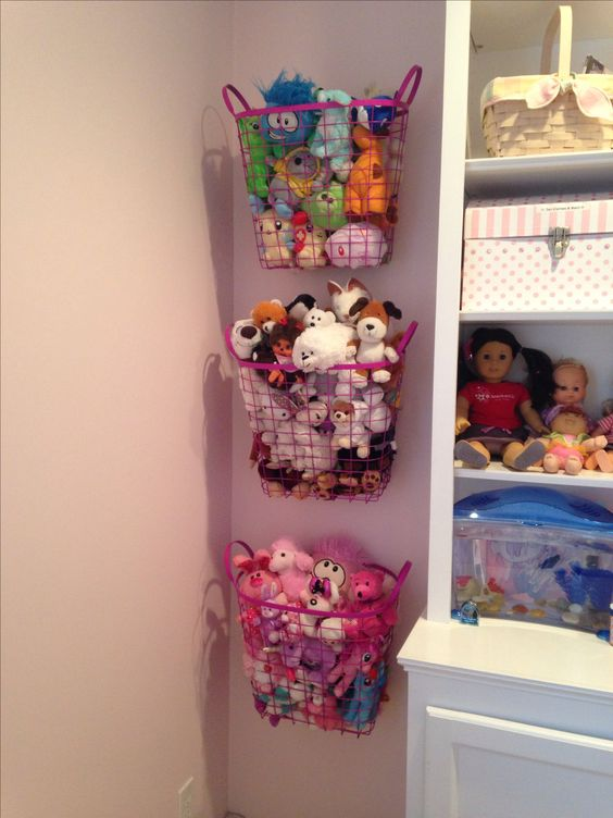 Organizing Stuffed Animals - spray painted metal baskets - attached to the wall with hooks, easy to take off the wall for play time!