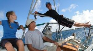 Eugene relaxes on the pushpit of Seal during a race on Majuro lagoon.