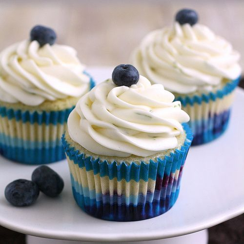 Blueberry Cupcakes with Lime Cream Cheese Frosting:  3/4 cup plus 2 tablespoons all-purpose flour, divided  3/4 cup cake flour  1 1/2 teaspoons baking powder  1/4 teaspoon salt  8 tablespoons (1 stick) unsalted butter, at room temperature  3/4 cup plus 2 tablespoons sugar  Zest of 1 lime  2 large eggs, at room temperature  1 teaspoon vanilla extract  2 tablespoons lime juice  1/2 cup plus 2 tablespoons milk, at room temperature  1 cup fresh blueberries     Frosting  8 oz. cream cheese  5…